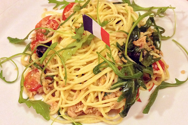 Spaghetti with tomato, olives, and tuna